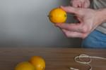 Poke a hole through each lemon.  We used a BBQ skewer.